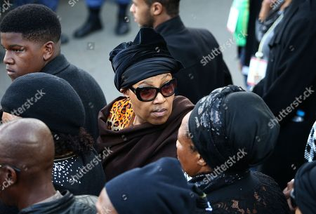 Stock Picture of Zenani Mandela, daughter of the late Winnie Madikizela-Mandela (C) outside her home in Soweto Orlando West as scores of people form a guard of honour to her house in Soweto, Johannesburg, South Africa, 13 April 2018. Winnie Mandela, former wife of Nelson Madela and anti-apartheid activist, passed away in a Johannesburg hospital on 02 April 2018 at age 81 and will be buried with a funeral on 14 April.