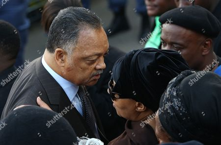 US civil rights activist Jesse Jackson (L) speaks with Zenani Mandela (R) daughter of the late Winnie Madikizela-Mandela outside her home in Soweto Orlando West as scores of people form a guard of honour to her house in Soweto, Johannesburg, South Africa, 13 April 2018. Winnie Mandela, former wife of Nelson Madela and anti-apartheid activist, passed away in a Johannesburg hospital on 02 April 2018 at age 81 and will be buried with a funeral on 14 April.