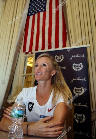 Stock Photo of Elite U.S. runner Shalane Flanagan speaks to reporters, in Boston. The 122nd running of the Boston Marathon is scheduled for Monday