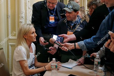 Elite U.S. runner Shalane Flanagan speaks to reporters, in Boston. The 122nd running of the Boston Marathon is scheduled for Monday