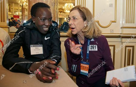 Edna Kiplagat, Kathrine Switzer. Boston Marathon defending women's champion Edna Kiplagat, left, of Kenya, speaks to Kathrine Switzer, the first official woman entrant in the Boston Marathon 50 years ago, at a news conference, in Boston. The 122nd running of the Boston Marathon is scheduled for Monday