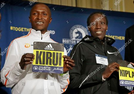 Stock Image of Geoffrey Kirui, Edna Kiplagat. Boston Marathon defending champions Geoffrey Kirui, left, and Edna Kiplagat, both of Kenya, pose for a photo at a news conference, in Boston. The 122nd running of the Boston Marathon is scheduled for Monday