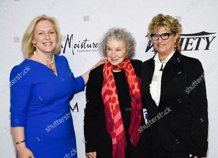 Kirsten Gillibrand, Margaret Atwood, Claudia Eller. Sen. Kirsten Gillibrand, left, honoree Margaret Atwood and Variety co-editor-in-chief Claudia Eller pose together at Variety's Power of Women: New York event at Cipriani Wall Street, in New York
