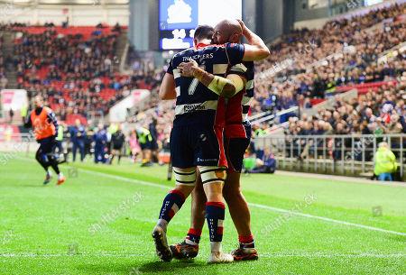 Soane TongaÕuiha of Bristol Rugby celebrates scoring a try with Sam Graham