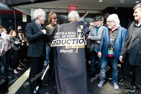 Jon Bon Jovi, John Francis Bongiovi Jr, Richie Sambora, Graeme Edge. Jon Bon Jovi, left, Richie Sambora, and Graeme Edge, are seen at Hall of Fame Dedication at Rock & Roll Hall of Fame, in Cleveland, Ohio