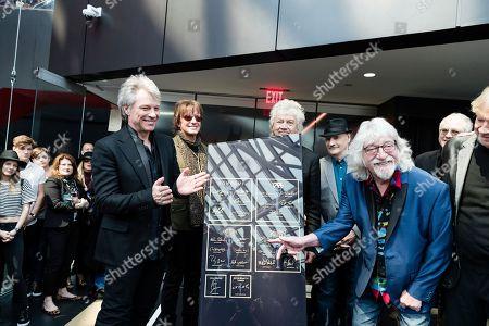 Stock Picture of Jon Bon Jovi, John Francis Bongiovi Jr, Richie Sambora, Graeme Edge. Jon Bon Jovi, left, Richie Sambora, and Graeme Edge, are seen at Hall of Fame Dedication at Rock & Roll Hall of Fame, in Cleveland, Ohio