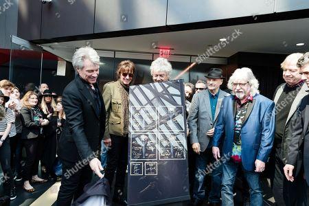 Stock Image of Jon Bon Jovi, John Francis Bongiovi Jr, Richie Sambora, Graeme Edge. Jon Bon Jovi, left, Richie Sambora, and Graeme Edge, are seen at Hall of Fame Dedication at Rock & Roll Hall of Fame, in Cleveland, Ohio