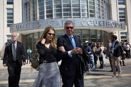 Actress Catherine Oxenberg departs with friend Stanley Zareff following the arraignment of NXIVM leader Keith Raniere in federal court, in New York. Oxenberg's daughter India has been named as a co-conspirator in a criminal complaint against cult leader Keith Raniere