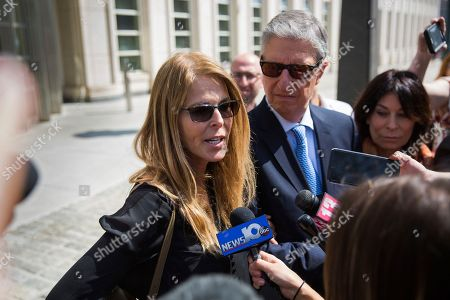 Actress Catherine Oxenberg, left, with Stanley Zareff and Toni Natalie, talks to the press following the arraignment of NXIVM leader Keith Raniere in federal court, in New York. Oxenberg's daughter India has been named as a co-conspirator in a criminal complaint against cult leader Keith Raniere