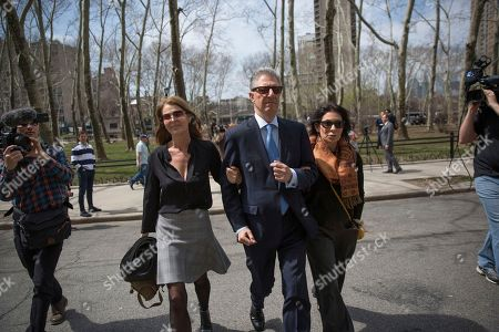 Actress Catherine Oxenberg, left, arrives at federal court with Stanley Zareff and Toni Natalie, who is Keith Raniere's ex-girlfriend, following the arraignment of NXIVM leader Raniere in federal court, in New York. Oxenberg's daughter India has been named as a co-conspirator in a criminal complaint against Raniere