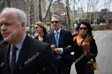 Actress Catherine Oxenberg, left, arrives at federal court with Stanley Zareff and Toni Natalie, who is Keith Raniere's ex-girlfriend, for the arraignment of NXIVM leader Raniere, in New York. Oxenberg's daughter India has been named as a co-conspirator in a criminal complaint against Raniere