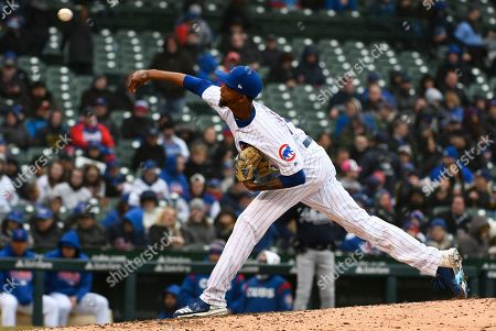 Chicago Cubs relief pitcher Carl Edwards Jr. (6) delivers during the eighth inning of a baseball game against the Atlanta Braves, in Chicago
