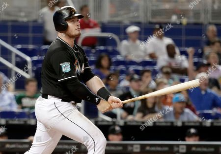 0bbb3cb2 Miami Marlins' Justin Bour watches his two-run home run during the seventh  inning