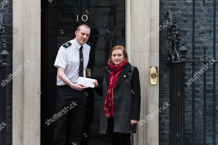 Labour MP Emma Dent Coad stands outside 10 Downing Street as she delivers a letter signed by MP's, celebrities, academics and trade unionists urging Prime Minister Theresa May to refrain from taking part in military action against Syria in response to the Assad regime's alleged chemical weapons attack in Douma, Eastern Ghouta, where at least 75 people died. Hundreds of anti-war demonstrators gathered today on Whitehall in central London to oppose further military intervention against Syria in order to avoid escalation of war and possible confrontation with Russia.