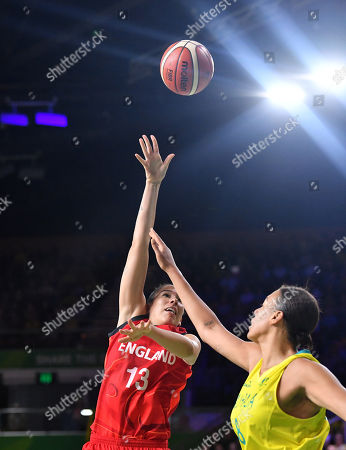 Azania Stewart of England gets a shot past Elizabeth Cambage of Australia during the Women's Basketball gold medal game between Australia and England on day ten of competition of the XXI Commonwealth Games, at Gold Coast Convention and Exhibition Centre on the Gold Coast, Australia, Saturday, April 14, 2018.