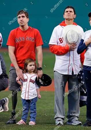 Jeff Bauman, Carlos Arredondo, Nora Bauman. Boston Marathon bombing survivor Jeff Bauman, left, stands with his rescuer Carlos Arredondo, right, as he rests his hands on the shoulders of daughter Nora, during a ceremony prior to a baseball game between the Boston Red Sox and Baltimore Orioles at Fenway Park in Boston, . Many of the bombing survivors were honored on this weekend's fifth anniversary of the bombing at the race in 2013