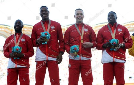 England's men's 4x100m relay team gold medalist, from left, Reuben Arthur, Zharnel Hughes, Richard Kilty and Harry Aikines-Aryeetey celebrate on the podium at Carrara Stadium during the 2018 Commonwealth Games on the Gold Coast, Australia