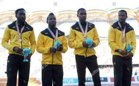 Jamaica's mens 4x100m relay bronze medal winning team Everton Clarke, Oshane Bailey, Warren Weir and Yohan Blake on the podium at Carrara Stadium during the 2018 Commonwealth Games on the Gold Coast, Australia