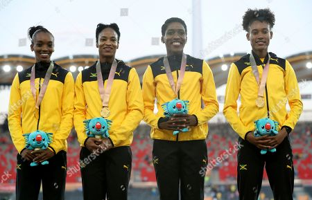 Jamaica's womens 4x400m relay gold medal winning relay team Christine Day, Anastasia Le-Roy, Janieve Russell and Stephanie Russell on the podium at Carrara Stadium during the 2018 Commonwealth Games on the Gold Coast, Australia