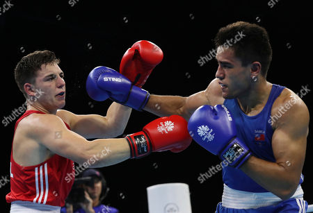 Wales' Sammy Lee, left, clashes against Samoa's Ato Plodzicki-Faoagali during their men's 81 kg gold medal boxing bout at the Oxenford Studios during the 2018 Commonwealth Games on the Gold Coast, Australia