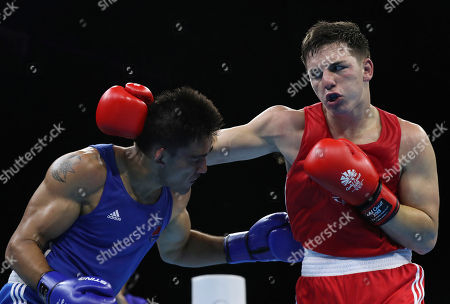 Wales' Sammy Lee, right, exchanges blows with Samoa's Ato Plodzicki-Faoagali during their men's 81 kg gold medal boxing bout at the Oxenford Studios during the 2018 Commonwealth Games on the Gold Coast, Australia