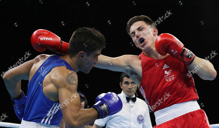 Wales' Sammy Lee, right, clashes against Samoa's Ato Plodzicki-Faoagali during their men's 81 kg gold medal boxing bout at the Oxenford Studios during the 2018 Commonwealth Games on the Gold Coast, Australia