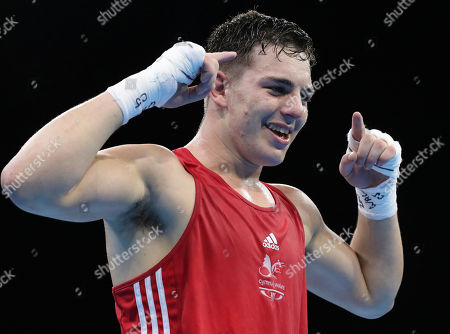 Wales' Sammy Lee celebrates after defeating Samoa's Ato Plodzicki-Faoagali during their men's 81 kg gold medal boxing bout at the Oxenford Studios during the 2018 Commonwealth Games on the Gold Coast, Australia