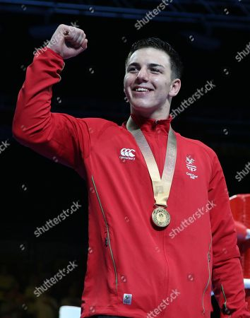 Gold medalist Sammy Lee of Wales celebrates during the medal ceremony for the men's 81 kg boxing at the Oxenford Studios during the 2018 Commonwealth Games on the Gold Coast, Australia