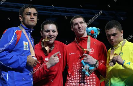 From left to right, silver medalist Ato Plodzicki-Faoagali of Samoa, gold medalist Sammy Lee of Wales, and bronze medalists Harley O'reilly of Canada and Clay Waterman of Australia pose for photographers during the medal ceremony for the men's 81 kg boxing at the Oxenford Studios during the 2018 Commonwealth Games on the Gold Coast, Australia