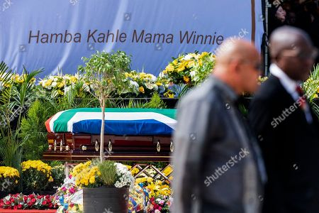 The coffin of Winnie Madikizela-Mandela stands in front of the words in Xhosa 'Go well mother Winnie' during the official state funeral at Orlando stadium in Soweto, Johannesburg, South Africa, 14 April 2018. Winnie Mandela, former wife of Nelson Madela and anti-apartheid activist, passed away in a Johannesburg hospital on 02 April 2018 at age 81.