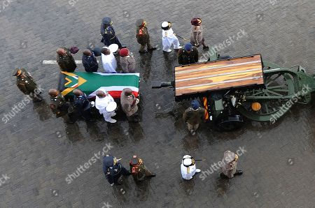 The coffin of Winnie Madikizela-Mandela is carried out of the official state funeral at Orlando stadium in Soweto, Johannesburg, South Africa 14 April 2018. Winnie Mandela, former wife of Nelson Madela and anti-apartheid activist, passed away in a Johannesburg hospital on 02 April 2018 at age 81.