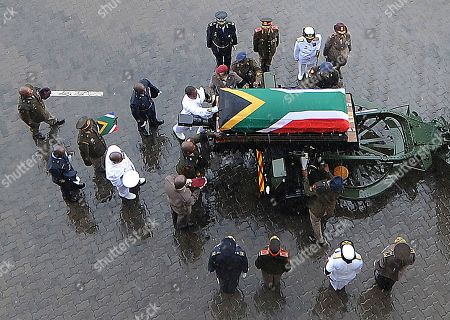 The coffin of Winnie Madikizela-Mandela is carried out of the official state funeral at Orlando stadium in the rain onto a carriage in Soweto, Johannesburg, South Africa 14 April 2018. Winnie Mandela, former wife of Nelson Madela and anti-apartheid activist, passed away in a Johannesburg hospital on 02 April 2018 at age 81.