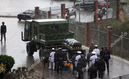 The coffin of Winnie Madikizela-Mandela is carried out of the official state funeral at Orlando stadium in the rain in Soweto, Johannesburg, South Africa 14 April 2018. Winnie Mandela, former wife of Nelson Madela and anti-apartheid activist, passed away in a Johannesburg hospital on 02 April 2018 at age 81.