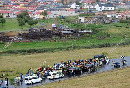 The funeral procession carrying the coffin of Winnie Madikizela-Mandela moves through Soweto after the official state funeral in Johannesburg, South Africa 14 April 2018. Winnie Mandela, former wife of Nelson Madela and anti-apartheid activist, passed away in a Johannesburg hospital on 02 April 2018 at age 81.