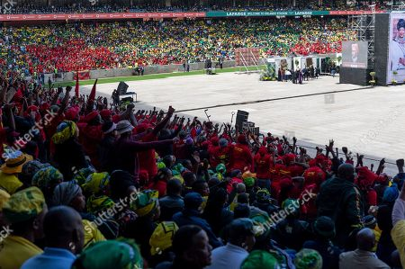 South Africans attend the official state funeral of Winnie Madikizela-Mandela at Orlando stadium in Soweto, Johannesburg, South Africa 14 April 2018. Winnie Mandela, former wife of Nelson Madela and anti-apartheid activist, passed away in a Johannesburg hospital on 02 April 2018 at age 81.