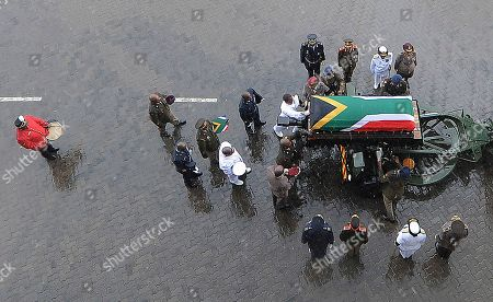 The coffin of Winnie Madikizela-Mandela is carried out of the official state funeral in the rain at Orlando stadium in Soweto, Johannesburg, South Africa, 14 April 2018. Winnie Mandela, former wife of Nelson Madela and anti-apartheid activist, passed away in a Johannesburg hospital on 02 April 2018 at age 81.