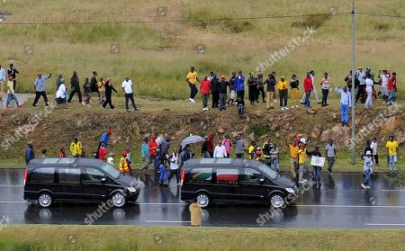South Africans line a street as the coffin of Winnie Madikizela-Mandela is driven following the official state funeral at Orlando stadium in Soweto, Johannesburg, South Africa 14 April 2018. Winnie Mandela, former wife of Nelson Madela and anti-apartheid activist, passed away in a Johannesburg hospital on 02 April 2018 at age 81.
