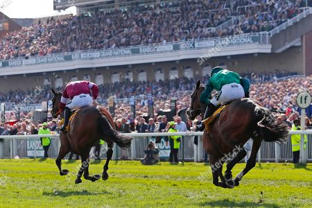 Identity Thief trained by Henry de Bromhead and ridden by Sean Flanagan on his way to winning the 4.20 Ryanair Stayers Hurdle (Registered As The Liverpool Hurdle) (Grade 1) followed by Wholestone trained by Nigel Twiston-Davies and ridden by Daryl Jacob