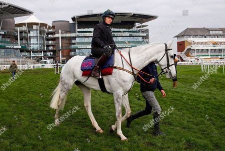 Baie Des Iles being ridden by Katie Walsh on the racecourse on the morning of Grand National Day