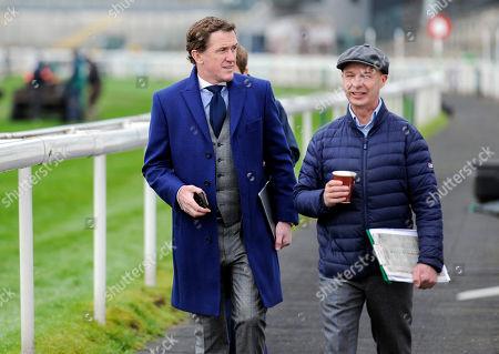 Former jockeys AP McCoy and Luke Harvey arrive at the racecourse