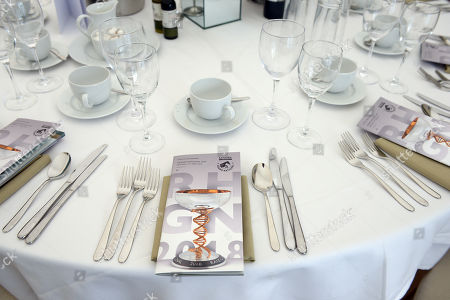 A detail of the laid tables in the Bob Champion Suite