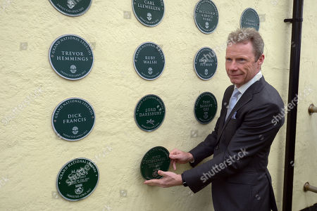 Mick Fitzgerald places his plaque on the wall as he celebrates his appointment as a Grand National Legend