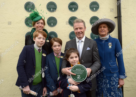 Mick Fitzgerald celebrates his appointment as a Grand National Legend with his wife Chloe, sons Zac and Oscar and his daughter Lola and Rose Patterson, Chairman of Aintree Racecourse