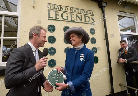 Rose Patterson, Chairman of Aintree Racecourse presents Mick Fitzgerald with a plaque celebrating his appointment as a Grand National Legend