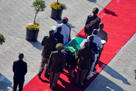 The flag draped coffin carrying the remains of anti-apartheid icon Winnie Madikizela-Mandela arrives for the funeral ceremony in Soweto, South Africa's Orlando stadium . Madikizela-Mandela died April 2, 2018, at the age of 81