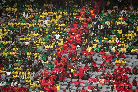 Wearing their trademark red shirts, EFF supporters of Julius Malema depart following their leader's speech at Soweto's Orlando stadium for the funeral service of anti-apartheid icon Winnie Madikizela-Mandela in Soweto, South Africa, . Mandela died April 2, 2018, at the age of 81