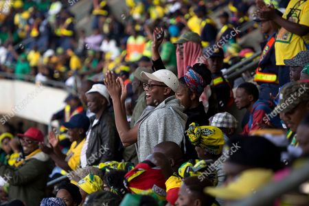 ANC supporters celebrate the legacy of anti-apartheid icon Winnie Madikizela-Mandela during her funeral ceremony at Soweto's Orlando stadium . Madikizela-Mandela died April 2, 2018, at the age of 81