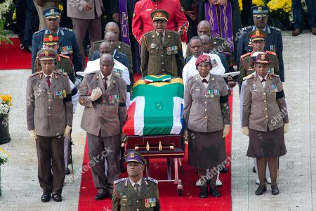 A military honor guard carries anti-apartheid activist Winnie Madikizela-Mandela's coffin, wrapped in the flag of South Africa, out of Orlando stadium following her funeral service, in Soweto, South Africa, . Tens of thousands of people sang, cheered and cried as the flag-draped casket of anti-apartheid activist Madikizela-Mandela was escorted from her official funeral on Saturday, after supporters defended her complex legacy with poetry and anger