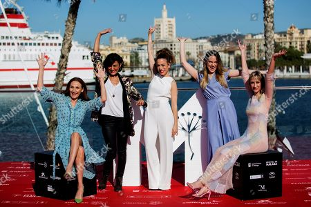 Spanish film director Andrea Jaurrieta (C) poses with Spanish actresses and cast members Mona Martinez (L), Ingrid Garcia Jonsson (R), and Irene Ruiz (2R) during the presentation of her film 'Ana de dia' at the 21st edition of Malaga Spanish Film Festival, in Malaga, southeastern Spain, 14 April 2018. The film was presented within the official section of the festival, which runs from 13 to 22 April.