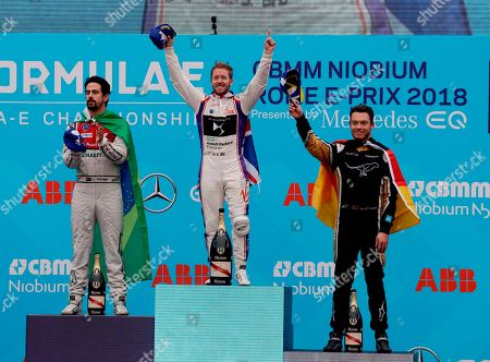 DS Virgin Racing team driver Sam Bird, center, is flanked by second placed Audi Sport ABT Schaeffler team Lucas di Grassi and third placed Techeetah team driver Andre Lotterer during the podium ceremony of the Formula E Rome E-Prix auto competition in Rome